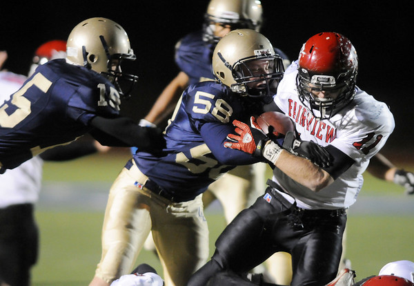 Legacy's Dylan Snodgrass and Devin Osbment tackle Fairview's Tucker Tharp during Friday's game at 5 Star Stadium in Thornton.<br /> <br /> October 9, 2009<br /> Staff photo/David R. Jennings