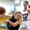 Legacy High School's Courtney Smith saves a ball from going out of bound in front of Georgina Ryder during a game against  Fairview on Tuesday, Jan. 15, at Fairview High School in Boulder. Legacy won 42-33.<br /> Jeremy Papasso/ Camera