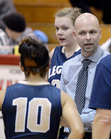 Legacy High School Head Coach Vince Kenson talks with his team while in a time out during a game against  Fairview on Tuesday, Jan. 15, at Fairview High School in Boulder. Legacy won 42-33.<br /> Jeremy Papasso/ Camera