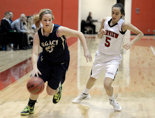 Legacy High School's Bree Paulson dribbles past Annika Lai during a game against  Fairview on Tuesday, Jan. 15, at Fairview High School in Boulder. Legacy won 42-33.<br /> Jeremy Papasso/ Camera
