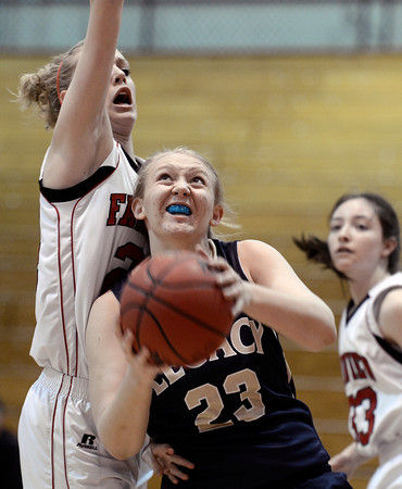 Legacy High School's Caitlyn Smith drives to the hoop past Kate Devenport during a game against Fairview on Tuesday, Jan. 15, at Fairview High School in Boulder. Legacy won 42-33.<br /> Jeremy Papasso/ Camera