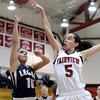 Legacy High School's Emiley Lopez takes a shot over Annika Lai during a game against  Fairview on Tuesday, Jan. 15, at Fairview High School in Boulder. Legacy won 42-33.<br /> Jeremy Papasso/ Camera