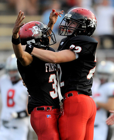 Fairview's Kenny Bell (left) and Tom Madden (right) celebrate Bell's opening kick off touchdown against Loveland during their football game at Recht Field in Boulder, Colorado September 4, 2009. CAMERA/Leffingwell