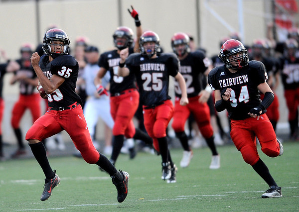 Fairview's Kenny Bell takes the opening kick off all the way for a touchdown against Loveland during their football game at Recht Field in Boulder, Colorado September 4, 2009. CAMERA/Leffingwell