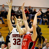 Fairview High School sophomore Georgina Ryder takes a shot over Loveland's Brooke Nyenhuis during a basketball game against Loveland High School on Thursday, Jan. 20, at Fairview High School. Fairview defeated Loveland 61-39. <br /> Jeremy Papasso/ Camera