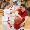 S0125BASKET3<br /> Fairview's #32, Matt Twist, puts pressure on Loveland's #44, Conor Lang, during their game at Fairview High School on Thursday evening, January 24th, 2013.<br /> <br /> <br /> Photo by: Jonathan Castner