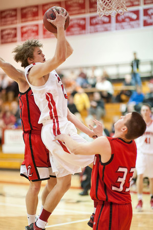 S0125BASKET7<br /> Fairview's #13, Sam Martin, gets a rebound against  Loveland's #33, Jacob Weinmaster, during their game at Fairview High School on Thursday evening, January 24th, 2013.<br /> <br /> <br /> Photo by: Jonathan Castner
