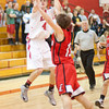 S0125BASKET2<br /> Fairview's #4, Gabe Tierney, puts up a shot as Loveland's #13, Joe Etling, attempts to block the shot during their game at Fairview High School on Thursday evening, January 24th, 2013.<br /> <br /> <br /> Photo by: Jonathan Castner