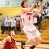 S0125BASKET4<br /> Fairview's #4, Gabe Tierney, puts up a shot as Loveland's #13, Joe Etling, defends during their game at Fairview High School on Thursday evening, January 24th, 2013.<br /> <br /> <br /> Photo by: Jonathan Castner