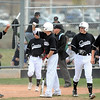 FVMON<br /> Monarch players celebrate a series of runs against Fairview.<br /> Photo by Marty Caivano/May 3, 2011