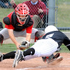 FVMON<br /> Fairview catcher Jordan Blair tags out Cody Sloan of Monarch at home plate.<br /> Photo by Marty Caivano/May 3, 2011