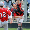 FVMON<br /> Fairview catcher Jordan Blair fumbles a fly ball at home plate against Monarch.<br /> Photo by Marty Caivano/May 3, 2011