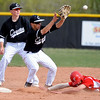 FVMON<br /> Fairview's Evan Thoning makes in safe to second base against Ryan Morton of Monarch. At left is Cole Maltese.<br /> Photo by Marty Caivano/May 3, 2011