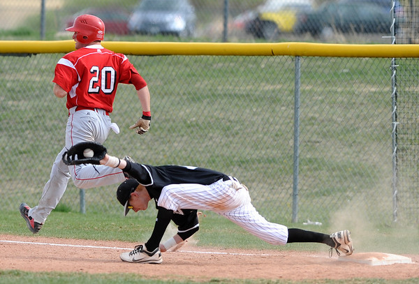 FVMON<br /> Monarch's Jeff Manders stretches to out Brian Sture at first base.<br /> Photo by Marty Caivano/May 3, 2011
