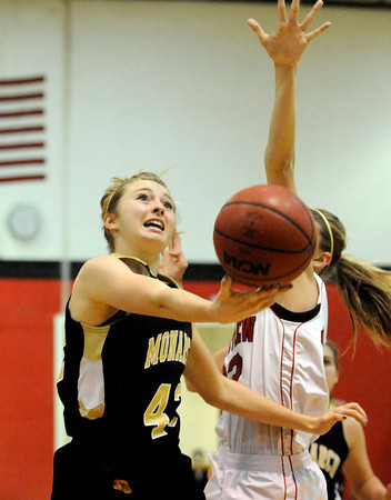 "Monarch High Schools' Bridget Anthony goes for a lay-up over a Fairview High School defender on Tuesday, Jan. 10, during a game at Fairview High School. Monarch won the game 55-34. For more photos of the game go to  <a href=""http://www.dailycamera.com"">http://www.dailycamera.com</a><br /> Jeremy Papasso/ Camera"