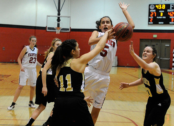 """Fairview High School's Annika Lai gets fouled by Monarch High School's Rebecca Richmond, No. 11, while going for a shot on Tuesday, Jan. 10, during a game at Fairview High School. Monarch won the game. For more photos of the game go to  <a href=""""http://www.dailycamera.com"""">http://www.dailycamera.com</a><br /> Jeremy Papasso/ Camera"""