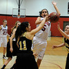 "Fairview High School's Annika Lai gets fouled by Monarch High School's Rebecca Richmond, No. 11, while going for a shot on Tuesday, Jan. 10, during a game at Fairview High School. Monarch won the game. For more photos of the game go to  <a href=""http://www.dailycamera.com"">http://www.dailycamera.com</a><br /> Jeremy Papasso/ Camera"