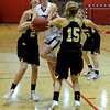 "Fairview High School's Hannah Hyde tries to squeeze through Monarch High School's Reagan Rohn, No.15, and Jac Malcolm-Peck, left, while going for a lay-up on Tuesday, Jan. 10, during a game at Fairview High School. Monarch won the game. For more photos of the game go to  <a href=""http://www.dailycamera.com"">http://www.dailycamera.com</a><br /> Jeremy Papasso/ Camera"