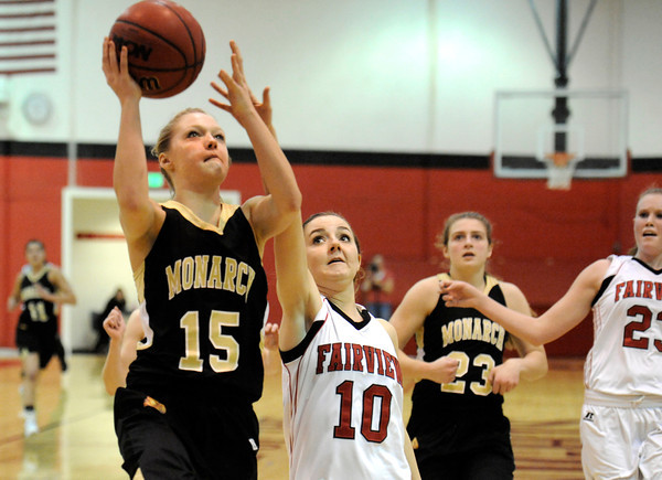 """Monarch High School's Raegen Rohn goes for a lay-up over Fairview High School's Meghan Higgins on Tuesday, Jan. 10, during a game at Fairview High School. Monarch won the game 55-34. For more photos of the game go to  <a href=""""http://www.dailycamera.com"""">http://www.dailycamera.com</a><br /> Jeremy Papasso/ Camera"""