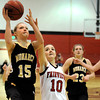 "Monarch High School's Raegen Rohn goes for a lay-up over Fairview High School's Meghan Higgins on Tuesday, Jan. 10, during a game at Fairview High School. Monarch won the game 55-34. For more photos of the game go to  <a href=""http://www.dailycamera.com"">http://www.dailycamera.com</a><br /> Jeremy Papasso/ Camera"