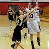 "Fairview High School's Sarah Kaufman goes for a shot over Monarch High School's Brenna Stimac on Tuesday, Jan. 10, during a game at Fairview High School. Monarch won the game. For more photos of the game go to  <a href=""http://www.dailycamera.com"">http://www.dailycamera.com</a><br /> Jeremy Papasso/ Camera"