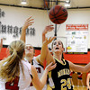 "Monarch High School's Jac Malcolm-Peck, right, tries to snag a rebound over Fairview High School's Shelby Davenport, No. 4, on Tuesday, Jan. 10, during a game at Fairview High School. Monarch won the game 55-34. For more photos of the game go to  <a href=""http://www.dailycamera.com"">http://www.dailycamera.com</a><br /> Jeremy Papasso/ Camera"
