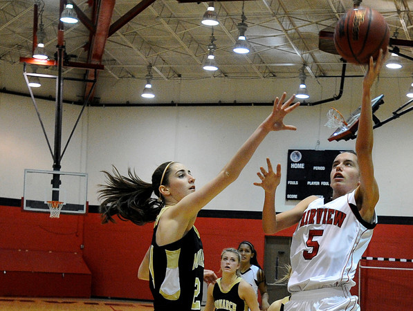 """Fairview High School's Annika Lai takes a shot over Monarch High School's Jac Malcolm-Peck on Tuesday, Jan. 10, during a game at Fairview High School. Monarch won the game. For more photos of the game go to  <a href=""""http://www.dailycamera.com"""">http://www.dailycamera.com</a><br /> Jeremy Papasso/ Camera"""