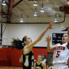 "Fairview High School's Annika Lai takes a shot over Monarch High School's Jac Malcolm-Peck on Tuesday, Jan. 10, during a game at Fairview High School. Monarch won the game. For more photos of the game go to  <a href=""http://www.dailycamera.com"">http://www.dailycamera.com</a><br /> Jeremy Papasso/ Camera"
