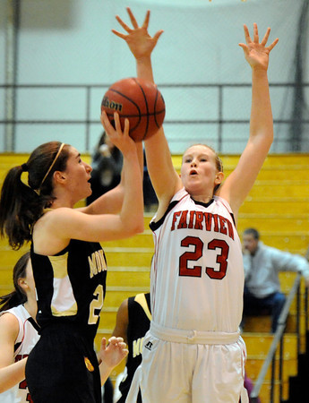 "Monarch High School's Jac Malcolm-Peck takes a shot over Fairview High School's Hannah Hyde on Tuesday, Jan. 10, during a game at Fairview High School. Monarch won the game 55-34. For more photos of the game go to  <a href=""http://www.dailycamera.com"">http://www.dailycamera.com</a><br /> Jeremy Papasso/ Camera"