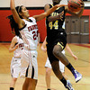 "Monarch High School's Alexus Johnson drives to the hoop past Fairview High School's Sonia Ghosh on Tuesday, Jan. 10, during a game at Fairview High School. Monarch won the game 55-34. For more photos of the game go to  <a href=""http://www.dailycamera.com"">http://www.dailycamera.com</a><br /> Jeremy Papasso/ Camera"
