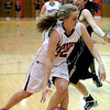 FVMON02<br /> Fairview's Sierra Bender drives past Rebecca Richmond of Monarch.<br /> Photo by Marty Caivano/Camera/Jan. 19, 2010