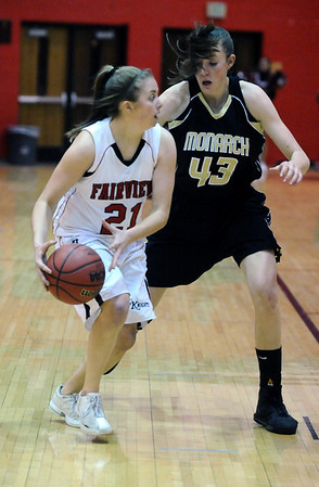 FVMON01<br /> Fairview's Casey Thayer looks to pass around Eliza Normen of Monarch.<br /> Photo by Marty Caivano/Camera/Jan. 19, 2010