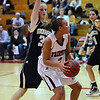 FVMON10<br /> Fairview's Carlee Lough looks to pass while being guarded by Katie O'Brien of Monarch.<br /> Photo by Marty Caivano/Camera/Jan. 19, 2010