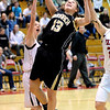 FVMON06<br /> Monarch's Ashton Davis gets in a shot after evading Kristen Narum of Fairview.<br /> Photo by Marty Caivano/Camera/Jan. 19, 2010