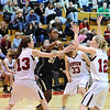 FVMON07<br /> Monarch's Alexus Johnson passes the ball while under pressure from, left to right, Nina Ball, Izzy Funke and Cassie Corrigan of Fairview. <br /> Photo by Marty Caivano/Camera/Jan. 19, 2010