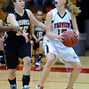 FVMON11<br /> Fairview's Kristen Narum searches for a free teammate while being guarded by Kelsey Fitzgerald of Monarch. <br /> Photo by Marty Caivano/Camera/Jan. 19, 2010