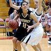 FVMON08<br /> Monarch's Rebecca Richmond pushes past Kristen Narum of Fairview.<br /> Photo by Marty Caivano/Camera/Jan. 19, 2010