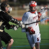 LACROSSE<br /> Fairview's Geoff Howell pushes past Dillon Ritger of Monarch.<br /> Photo by Marty Caivano/Camera/April 1, 2010