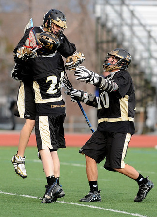 LACROSSE<br /> Tyler Thorson, background, is congratulated by Dillon Ritger, left, and Nate Puldy, right, after scoring a goal against Fairview.<br /> Photo by Marty Caivano/Camera/April 1, 2010