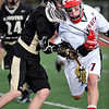 LACROSSE<br /> Fairview's John Weil loses the ball while being checked by Kyle Doner of Monarch.<br /> Photo by Marty Caivano/Camera/April 1, 2010