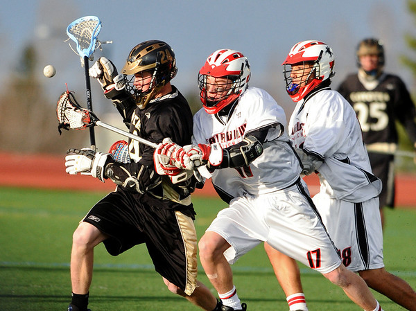 LACROSSE<br /> Fairview's Jimmy Kelly, center, and Michael Rae, right, force the ball from Dillon Ritger of Monarch.<br /> Photo by Marty Caivano/Camera/April 1, 2010