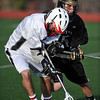 LACROSSE<br /> Fairview's Will Kinnard fights for the ball against Brian Carrol of Monarch.<br /> Photo by Marty Caivano/Camera/April 1, 2010