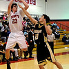 "Fairview's Gabe Tierney takes a shot over Monarch's Nathan Brooks during a basketball game against Monarch High School on Wednesday, Dec. 7 at Fairview. Fairview won the game 50-26. For more photos of the game go to  <a href=""http://www.dailycamera.com"">http://www.dailycamera.com</a><br /> Jeremy Papasso/ Camera"