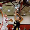 "Fairview's Holden Killeen goes for a shot over Monarch's Ben Beauchamp during a basketball game against Monarch High School on Wednesday, Dec. 7 at Fairview. Fairview won the game 50-26. For more photos of the game go to  <a href=""http://www.dailycamera.com"">http://www.dailycamera.com</a><br /> Jeremy Papasso/ Camera"