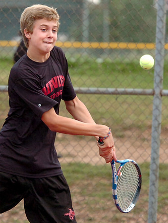 "Fairview High School's Brock Dehaven returns the ball on Thursday, Sept. 15, during a doubles tennis match against Monarch High School      at Fairview High School in Boulder. For more photos of the matches go to  <a href=""http://www.dailycamera.com"">http://www.dailycamera.com</a><br /> Jeremy Papasso/ Camera"