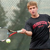 "Fairview High School senior Johnny Combs returns the ball on Thursday, Sept. 15, during a tennis match against Monarch's Danny Wright at Fairview High School in Boulder. For more photos of the matches go to  <a href=""http://www.dailycamera.com"">http://www.dailycamera.com</a><br /> Jeremy Papasso/ Camera"