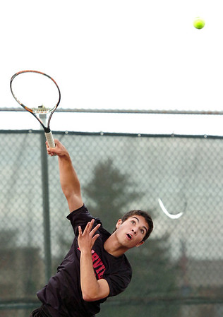 "Fairview High School junior Eli Winegardner serves the ball on Thursday, Sept. 15, during a tennis match against Monarch's Justin Nguyen at Fairview High School in Boulder. For more photos of the matches go to  <a href=""http://www.dailycamera.com"">http://www.dailycamera.com</a><br /> Jeremy Papasso/ Camera"