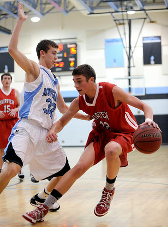 Fairview's Michael Melillo (right) drives in for a shot while being guarded by Mountain Range's Mitch Castillo (left) during their basketball game at Mountain Range High School in Westminster, Colorado February 12, 2010.  CAMERA/Mark Leffingwell
