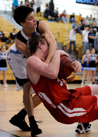 Fairview's Daniel Flora (right) wrestles Mountain Range's Dom Vargas for the ball during their basketball game at Mountain Range High School in Westminster, Colorado February 12, 2010.  CAMERA/Mark Leffingwell