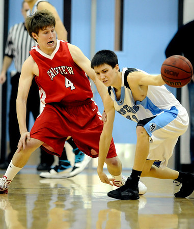Fairview's Will Oldham (left) guards Mountain Range's Derrick Valdez (right) during their basketball game at Mountain Range High School in Westminster, Colorado February 12, 2010.  CAMERA/Mark Leffingwell